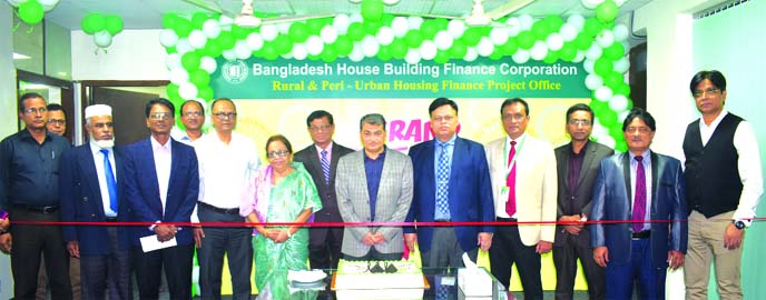 Professor Dr. Md. Salim Uddin, Chairman, Board of Directors of Bangladesh House Building Finance Corporation (BHBFC), inaugurating its Rural and Peri-urban Housing Finance Project office at it's headquartering in the city on Wednesday. The project financed by the Islamic Development Bank (IsDB) will play an important role in development of affordable and land saving housing in the rural and Peri-urban areas, growth centers of the country. Neelufar Ahmed, Md. Moniruzzaman, Dr. Md. Humayun Kabir Chowdhury, Tapon Kumar Ghosh, Directors and Debasish Chakrabarty, Managing Director of BHBFC were also present.