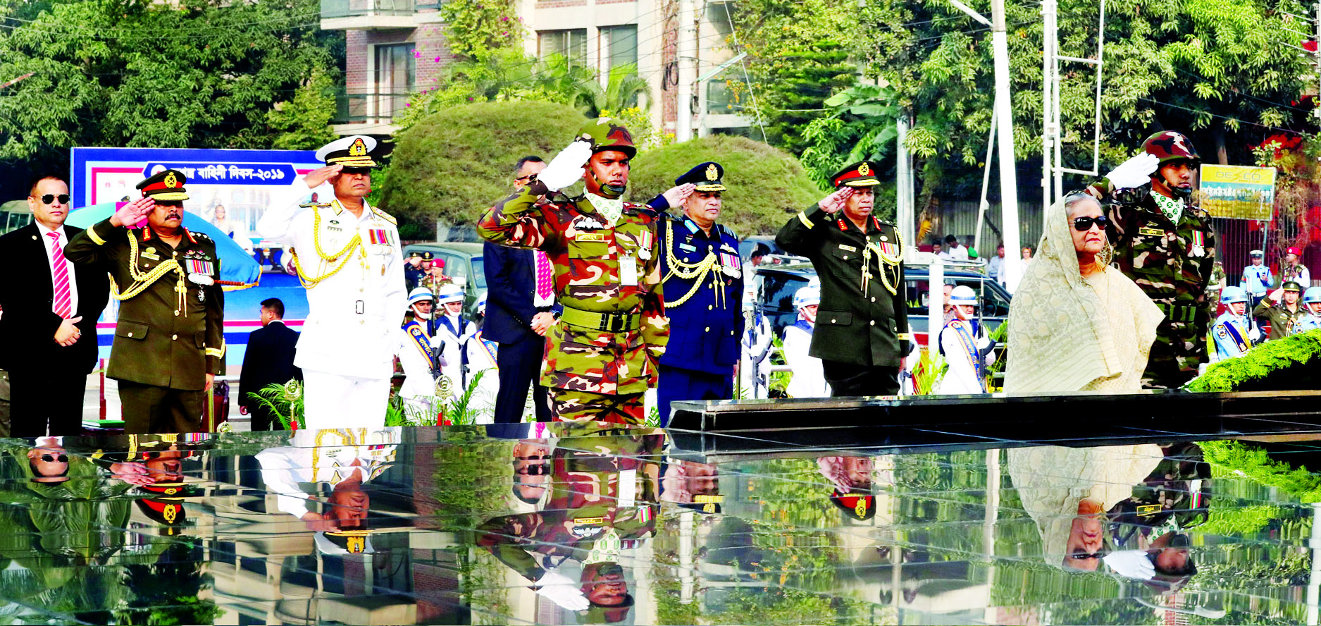 Prime Minister Sheikh Hasina stands in solemn silence as a mark of profound respect to the memories of the armed forces martyrs who made supreme sacrifices during the War of Liberation, after placing a wreath at the Shikha Anirban (flame eternal) in Dhaka Cantonment on Thursday morning on the occasion of the Armed Forces Day.