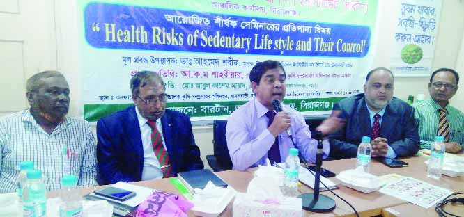 BOGURA: Additional Director of Agriculture Extension Department AKM Shahariar speaking as Chief Guest at a seminar on 'Health Risks of  Sedentary Life -style and Their Control ' on Wednesday.