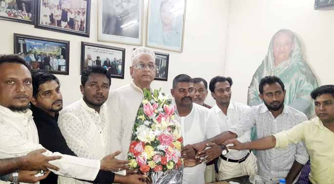 Leaders of newly elected Chandgaon Sramik League  greeting Bokktiar Uddin Khan, President, City Sramik League at his residence recently.