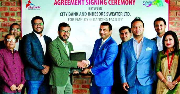 Md. Abdul Wadud, DMD of City Bank Limited and Mohammed Rokunuzzaman Milon, Chairman of Indesore Sweater Limited, exchanging an agreement signing document at the garment's head office in Gazipur recently. High officials from both the organizations were present.