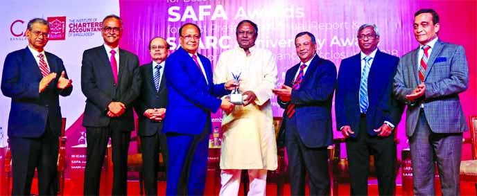 M. Kamal Hossain, Managing Director of Southeast Bank Limited, receiving the