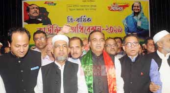 Newly- elected President  MA Salam (Second from right) and  General Secretary Ataur Rahman Ata (Second from left) of the Chattogram North District Awami League.