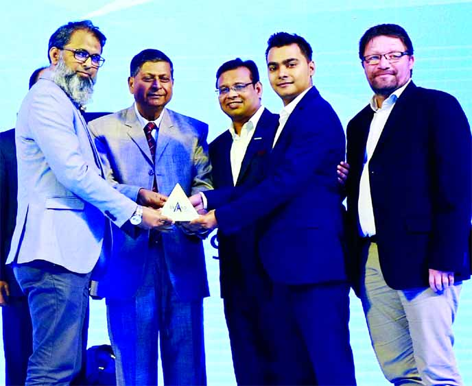 Abdul Alim Munshi, Executive Director (Business Transformation) of Akij Food & Beverage Limited, receiving the 'Best Brand Award-2019' in the carbonated soft drinks category organized by Brand Forum at La Meridian Hotel in the city on Saturday. Muntasir Mamun, Assistant Brand Manager of the company were also present.