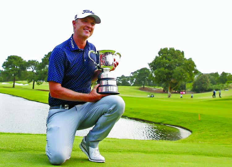 Matt Jones of Australia poses with the Stonehaven Cup after winning The Australian Open Golf Championship at The Australian Golf Club in Sydney on Sunday.