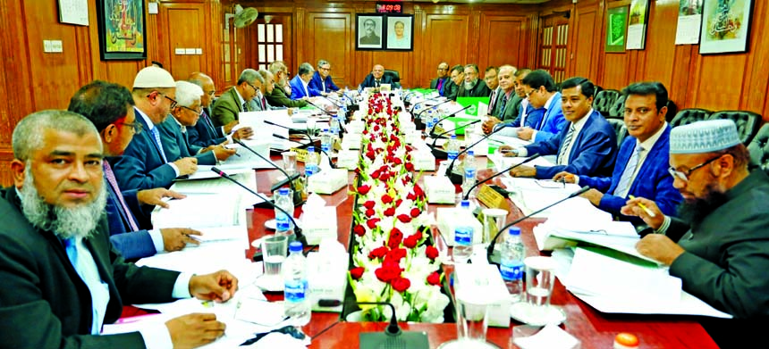 Professor Md. Nazmul Hassan, Chairman of Islami Bank Bangladesh Limited, presiding over its meeting at the bank's head office in the city on Tuesday. Md. Shahabuddin, Vice-Chairman, Md. Mahbub ul Alam, CEO and directors of the bank Jwere also present.