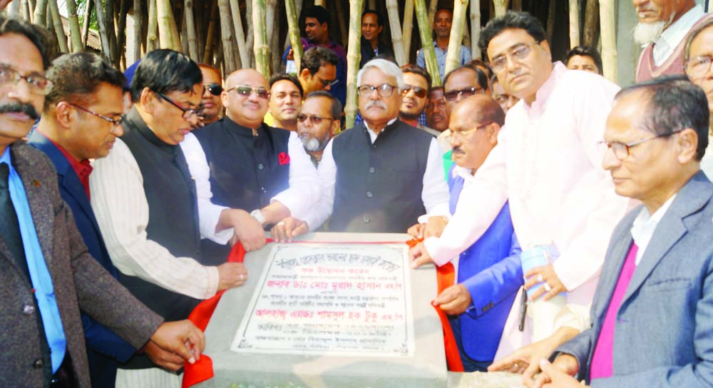 SANTHIA (Pabna): State Minister for Information Dr  Murad Hasan MP inaugurating construction works of 1 st floor of Santhia Press Club as Chief Guest on Monday.