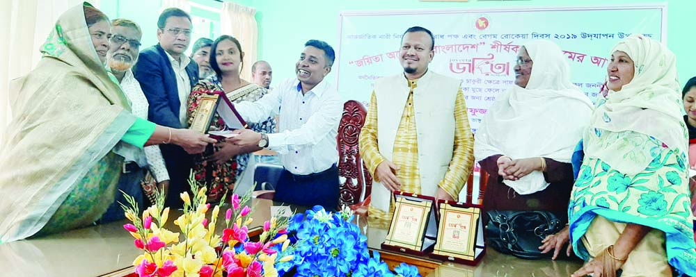 BHANGURA (Pabna): Syed Asrafujjaman, UNO and Md Baki Billah, Chairman, Upazila Parishad  distributing the medal  among the winners of Begum Rokeya Padak  at Bhangura Upazila Parishad Hall Room marking the Rokeya Day on Monday.
