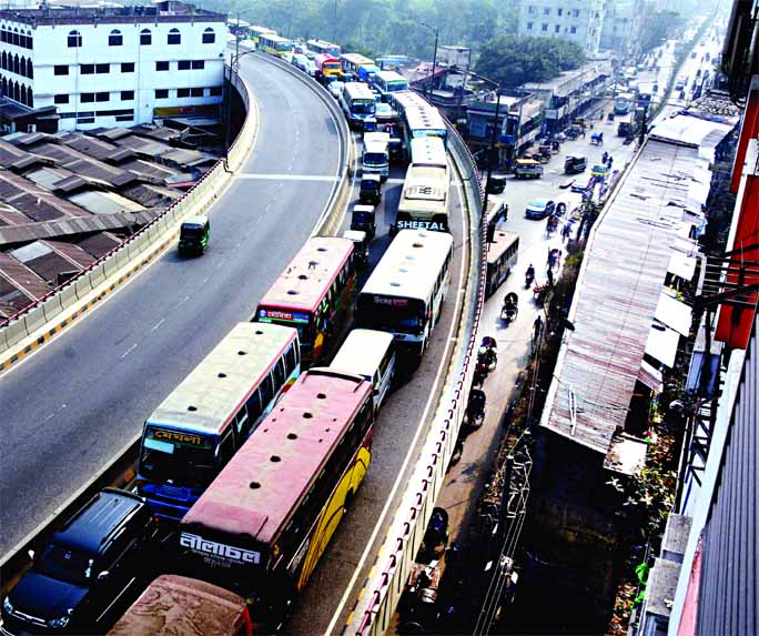 Hundreds of vehicles got stuck at a huge traffic tailback on Hanif Flyover on Wednesday.