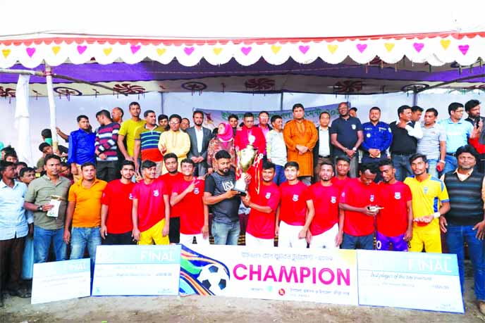 Sonarpara Bachai Elevens, the champions in the UNO Cup Football Tournament with the chief guest Upazila Nirbahi Officer (UNO) of Ukhiya Upazila Md Nikaruzzaman, Upazila Chairman of Ukhiya Upazila Professor Hamidul Haque Chowdhury, the other officials of Ukhiya Upazila Council and the officials of International Organization of Migration (IOM) pose for photograph at Ukhiya Government High School Playground in Ukhiya Upazila, Cox's Bazar District on Friday. IOM and Action Aid Bangladesh gave all sorts of support to stage the tournament successfully.