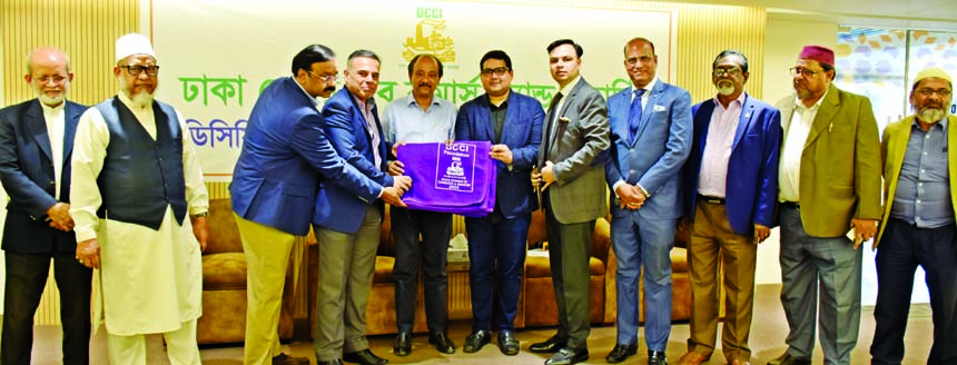 Osama Taseer, President of Dhaka Chamber of Commerce & Industry (DCCI), handing over warm cloths/blankets to Suja Ur Rob Chowdhury, President of Dinajpur Chamber of Commerce & Industry for distributing among the distressed people of different parts of the country on Saturday. Imran Ahmed, Vice President, Shams Mahmud, Mohammad Bashiruddin, Hossain A Sikder, Deen Mohammad, Enamul Haque Patwary, Directors of the organization were also present.