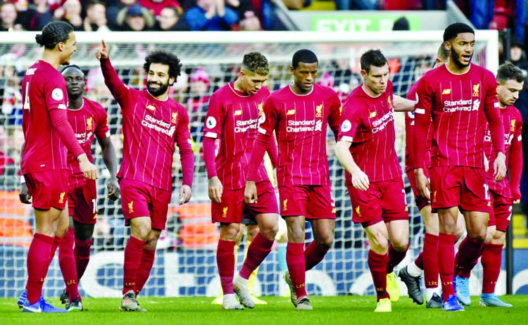 Liverpool's Mohamed Salah (3rd left) celebrates with teammates after scoring his sides first goal during the English Premier League soccer match between Liverpool and Watford at Anfield stadium in Liverpool, England on Saturday.