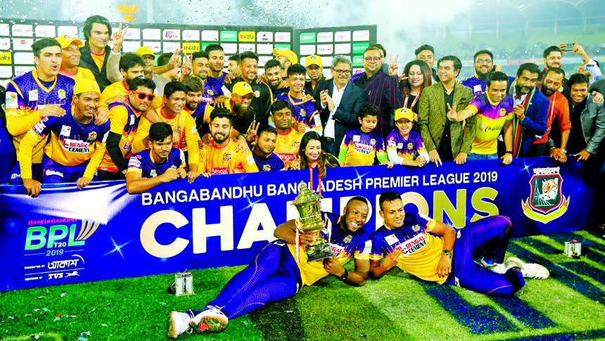 Members of Rajshahi Royals, the champions of   the Bangabandhu Bangladesh Premier League (BBPL) Twenty20 cricket pose with the trophy of the BBPL at the Sher-e-Bangla National Cricket Stadium on Friday.