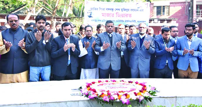 Bangabandhu Sheikh Mujibur Rahman Maritime University Vice-Chancellor Rear Admiral M Khaled Iqbal along with other high officials offering Munajat after placing wreaths at the Mazar of the Father of the Nation Bangabandhu in Tungipara on Friday.