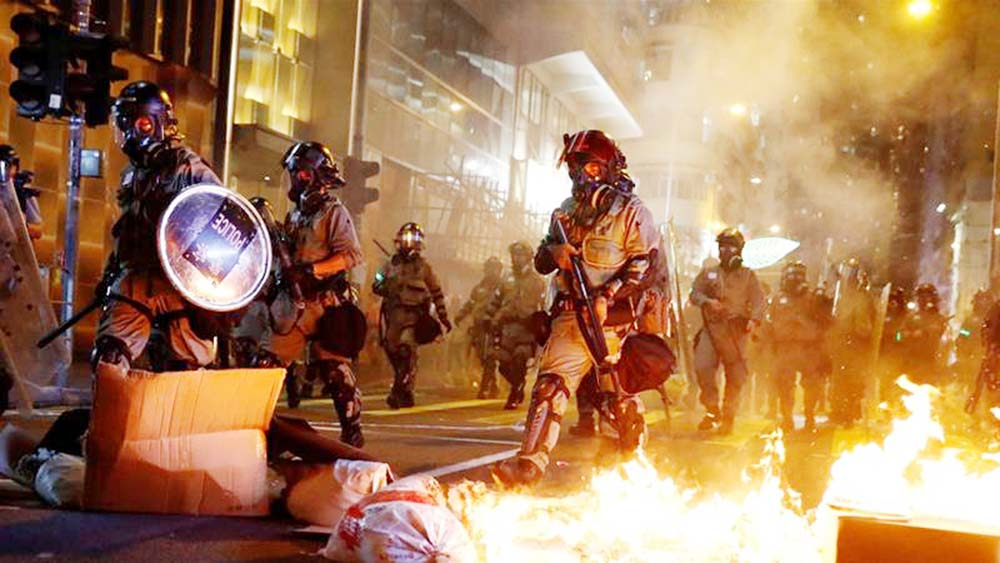 Police fire tear gas to disperse thousands in central Hong Kong