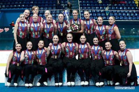 Members of Group Skyliners of the United States pose on the podium after winning the 16th Zagreb Snowflakes Trophy synchronized skating competition in Zagreb, Croatia on Saturday.