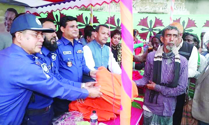 KISHOREGANJ: Md Mashrukur Rahman Khaled BPM (Bar), SP, Kishoreganj distributing blankets among the poor people at Tarail Upazila  recently.