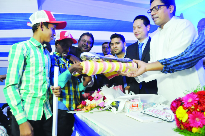 NATORE: Blankets with maflours and scarfs were distributed among the poor and disabled people  at Singair Upazila organised by China Railway International Group Co  Ltd (CRIG) recently.