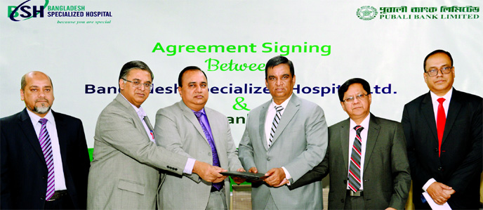 Md. Abdul Halim Chowdhury, CEO of Pubali Bank Limited and Al Emran Chowdhury, CEO of Bangladesh Specialized Hospital Limited, exchanging document after signing an agreement at the banks head office in the city on Monday. Under the deal, all card holders and employees of the bank will avail up to 25 per cent discount while taking healthcare services from the hospital. Top executives from both sides were also present.