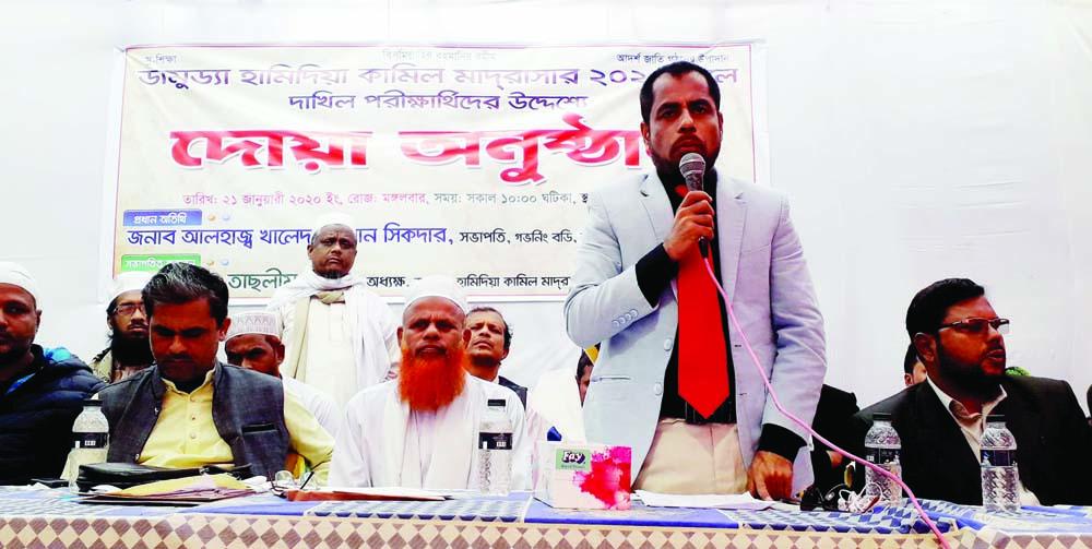 DAMUDYA (Shariatpur):   Industrialist Alhaj Khaled Rahman Sikdar, President, Governing body  of Damudya Hamidiya Kamil Madrasa  speaking at a Doa Mahfil  yesterday organised  for the Dakhil examinees of the madrasa this year.