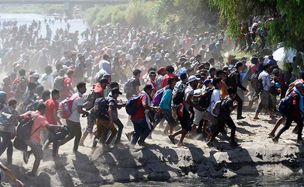 Migrants crossing the Suichate River, the natural border between Guatemala and Mexico.