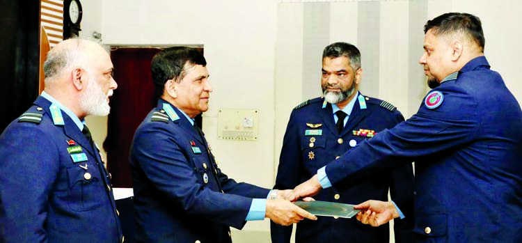 Assistant Chief of Air Staff (Operations) of BAF, Air Vice Marshal M Abul Bashar giving away certificates among the graduating officers of No 08 Squadron Commanders' Officers' Course of BAF at CSTI, Dhaka Cantonment on Tuesday.