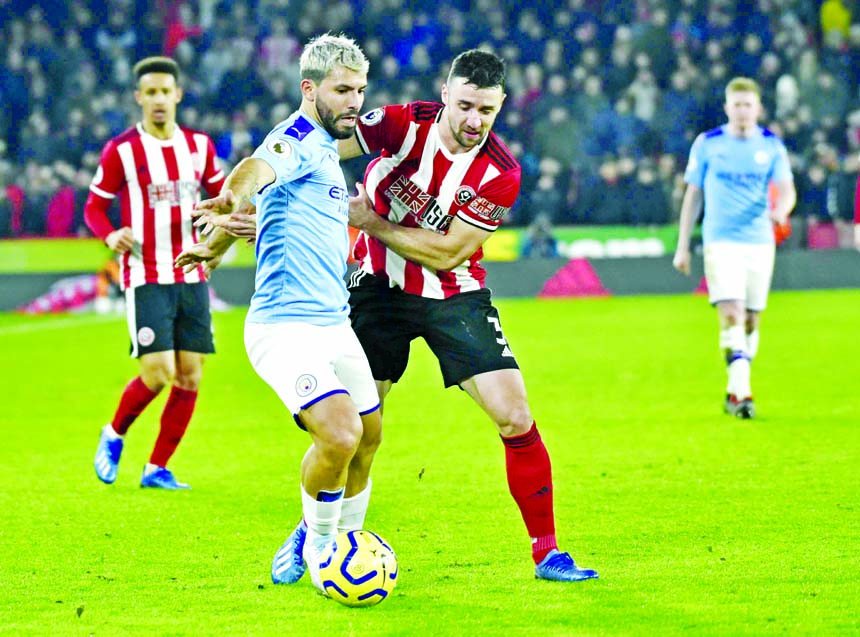 Aguero strikes as Man City blunt Blades