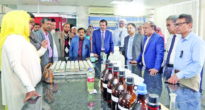 GAZIPUR: Kamalaranjan Das (3rd right) and  Balai Krishna Hazra (5th right),  two Additional Secretaries of Research Wing,  Ministry of Agriculture  visited Bangladesh Agricultural Research Institute (BARI) on Wednesday. BARI Director General Dr Abul Kalam Azad (4th right) was present while the guests visited Soil Science Division Laboratory.