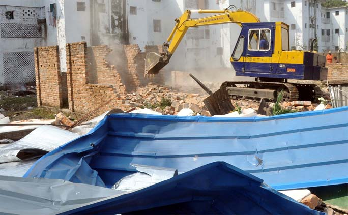 Railway authority conducted an  eviction drive by demolishing illegal constructions at Tiger-pass area   yesterday.