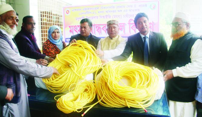 MODHUKHALI (Faridpur): Upazila Chairman Moniruzzaman Bachchu and  District Fisheries Officer  Md Monirul Islam  distributing ropes for nets  among fishermen on Thursday .