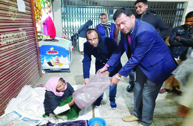 NETRAKONA: Azharul Islam Arun, Convener, Muktijoddah Santan Command, Netrakona Pourashav Unit distributing blankets and winter clothes among poor floating people  on Friday.
