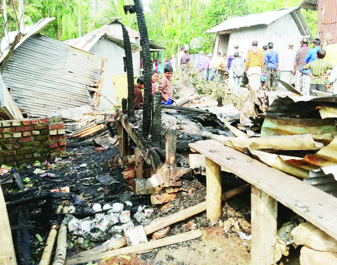 BETAGI (Barguna): A devastating fire gutted three shops at Jhopkhali Bazar in Betagi Upazila on Friday .