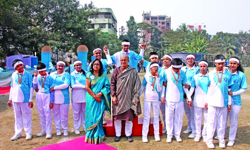 The winners in the Annual Sports Competition of Beautiful Mind School with the chief guest Dr Tawfiq-e-Elahi Chowdhury, Prime Minister Sheikh Hasina's Energy and Mineral Resources Adviser and the Headmistress of the School pose for a photo at Uttara Friends Club Ground recently.