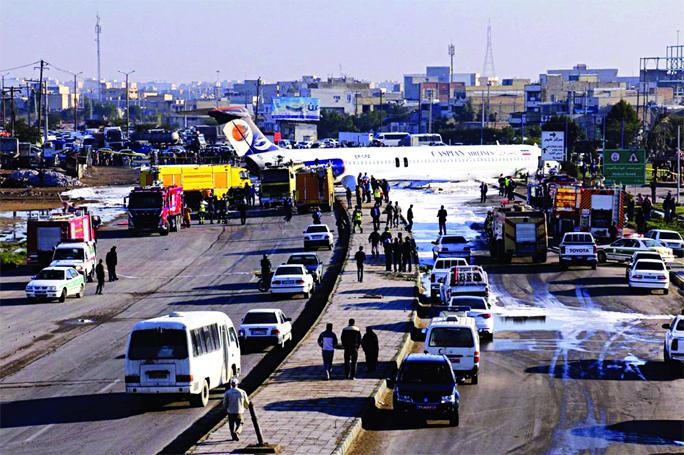 Aging Iran plane crash-lands on highway