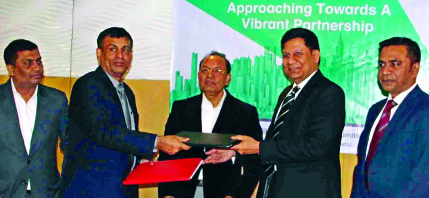 Rajesh Surana, CEO of LafargeHolcim Bangladesh Limited (LHBL) and Commodore Bipan Kumar Saha, CEO of Borak Real Estate Limited (a sister concern of Unique Group), exchanging document after signing an agreement at The Westin, Dhaka on Sunday. Under the deal, the real estate company will use the two premium cement brands Supercrete and Holcim in their ongoing and upcoming projects. Mohammad Noor Ali, Managing Director of Unique Group and other high officials from both sides were also present.