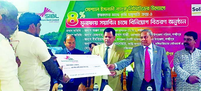 Md Sirajul Hoque, Deputy Managing Director of Social Islami Bank Limited (SIBL) and Anjon Chandra Paul, Deputy Commissioner of Laxmipur, distributing agricultural loan cheques at 4 percent interest rate among Soybean cultivators of Komolnagar recently.