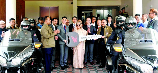 In presence of Prime Minister Sheikh Hasina , Managing Director and Chief Executive Officer of Bangladesh Honda Private Limited Himihiko Katsuki handing over the keys of two 1800CC motorcycles to SSF Director General Major General Majibur Rahman at a function at the Prime Minister's Office (PMO) on Monday.