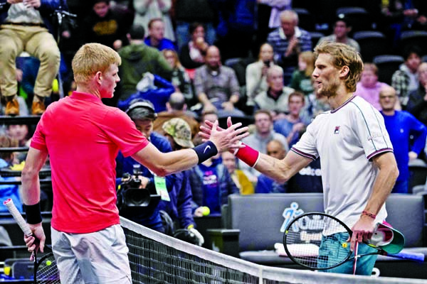 Kyle Edmund (left) of Britain, shakes hands with Andreas Seppi, of Italy, after Edmund's 7-5, 6-1 win in the final of the New York Open tennis tournament on Sunday.