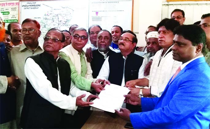 MORELGANJ (Bagerhat):  Adv Amirul Alam Milon, Awami League nominated candidate submitting nomination paper in by-election of  Bagerhat-4 Constituency to  Md Mustafa Kamal, Upazila Election Officer yesterday.