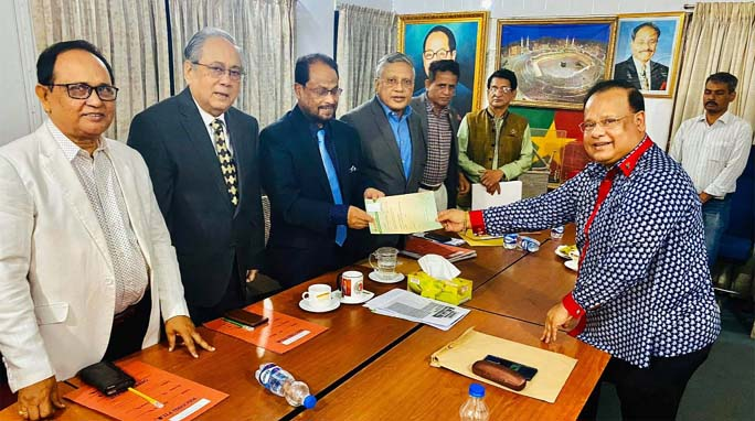 G M Kader, Chairman, Jatiya Party (JaPa) handing  over nomination paper to JaPa  nominated mayor candidate  Alhaj Soliaman Alam Shetty for CCC election on Monday.