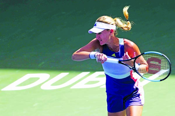Kristina Mladenovic of France, returns the ball to Karolina Pliskova of Czech Republic, during a match of the Dubai Duty Free Tennis Championship in Dubai of United Arab Emirates on Wednesday.