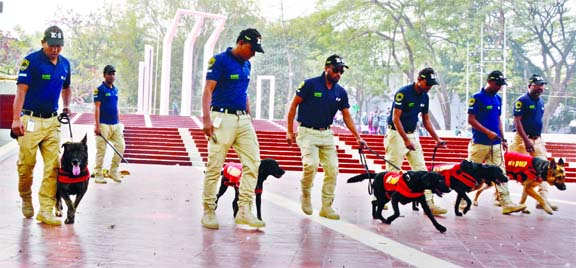 'Dog Squad' of Dhaka Metropolitan Police (DMP) conducts a sweeping in and around the Central Shaheed Minar in the capital on Wednesday for peaceful observance of Shaheed Dibas and International Mother Language Day on February 21.