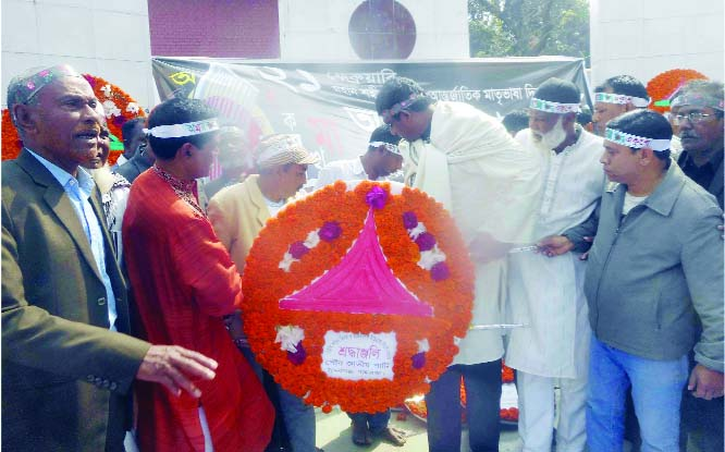 SUNDARGANJ (Gaibandha): Barrister Shameem Haider Patwary placing wreaths at the Central Shaheed Minar at Sundarganj Upazila  in the occasion of the International Mother Language Day on Friday.
