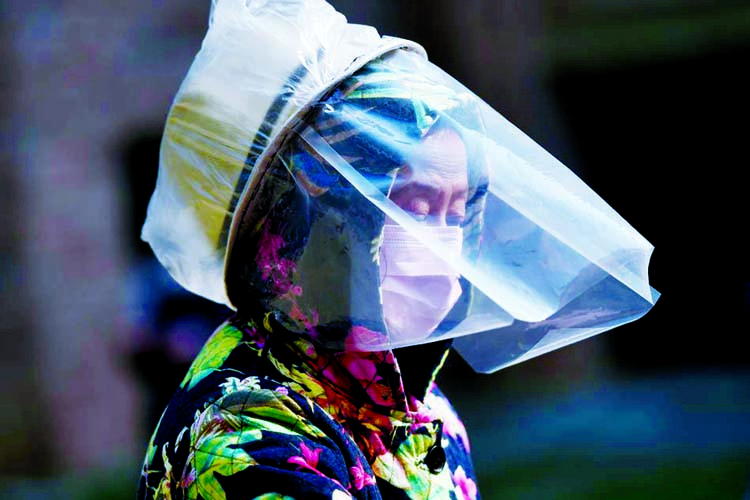 Drop in new China virus cases as toll reaches 2,345