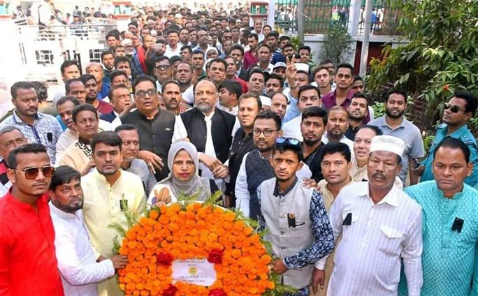 M A Latif MP with other leaders of Awami League placing wreaths at the Shaheed Minar marking the International Mother language Day on Friday.