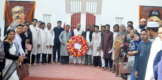Students and teachers of Kazim Ali School and College  placing wreaths at the Shaheed Minar  in observance of the International Mother Language Day on Friday.