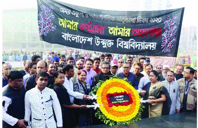 GAZIPUR: Prof Dr M A Mannan, VC, Bangladesh Open University placing wreaths at the Shaheed Minar at the campus marking the International Mother Language Day on Friday.  Among others, Prod Dr Khondokar Mokaddem Hossain, Pro- VC, Prof Dr Ashfaque Hossain, Treasurer and Dr Md Shafiqul Alam, Registrar  were present.