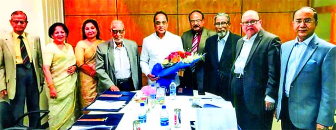 Engr Bikash Dewan, Managing Director of Dhaka Power Distribution Company Limited (DPDC) and Engr Taqsem A Khan, Managing Director of Dhaka WASA, shaking hands after signing a MoU to improve the existing services at WASA Bhaban on Wednesday. High officials from both sides were also present.