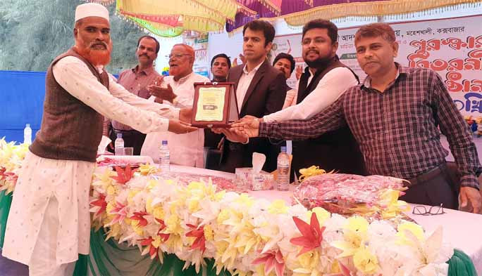 Zihad Bin Ali,  President,  School Management Committee and UP Chairman  is being greeted by  Md. Jamirul Islam, UNO at the prize giving ceremony  of annual sports and cultural  competition of  Chotto Moheshkhali Adarsha High School  in  Cox's Bazar  on Tuesday.