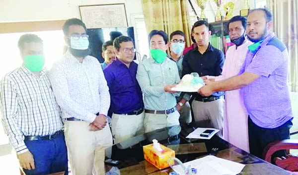 BETAGI(Barguna): Dr Abdullah, Upazila Lifestoke Officer  and Md Ahsan Habib, UNO  handing over 12 sets of  Personal Protective Equipments(PPE) to Dr Tang Mong, Upazila Health and Family Planning Officer for doctors of Betagi Upazila Health Complex on Tuesday.